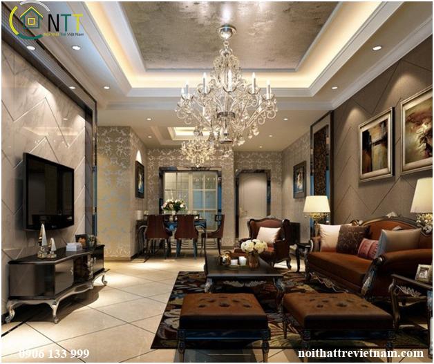 Mẫu nội thất phòng khách cổ điển với bộ sofa màu nâu sang trọng và chiếc đèn chùm tạo điểm nhấn