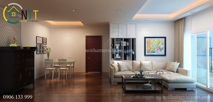 Phòng khách liền bếp được trang trí trần thạch cao cùng đèn hắt ánh sáng vàng và đèn downlight