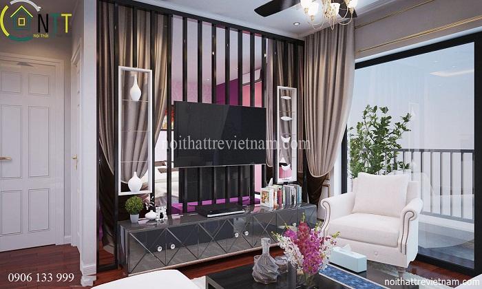 Vách ngăn giữa phòng khách và phòng ngủ đồng thời là kệ tivi tiện dụng